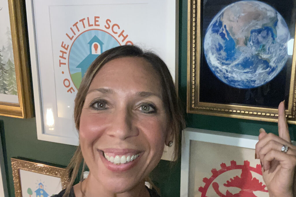 smiling woman pointing at planet earth blast off